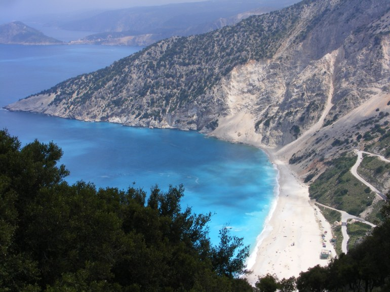 Looking over the beautiful Myrtos Beach in Kefalonia, surrounded by white chalky cliffs covered in green vegetation